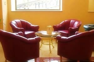property waiting room living room orange chair Suite seat leather