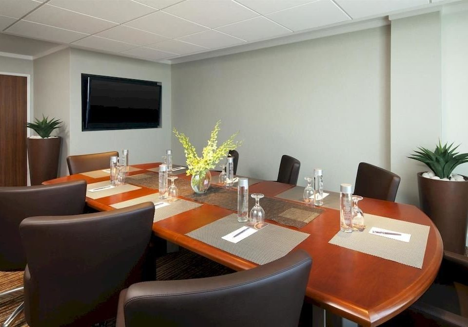 property conference hall waiting room Suite condominium restaurant living room leather dining table