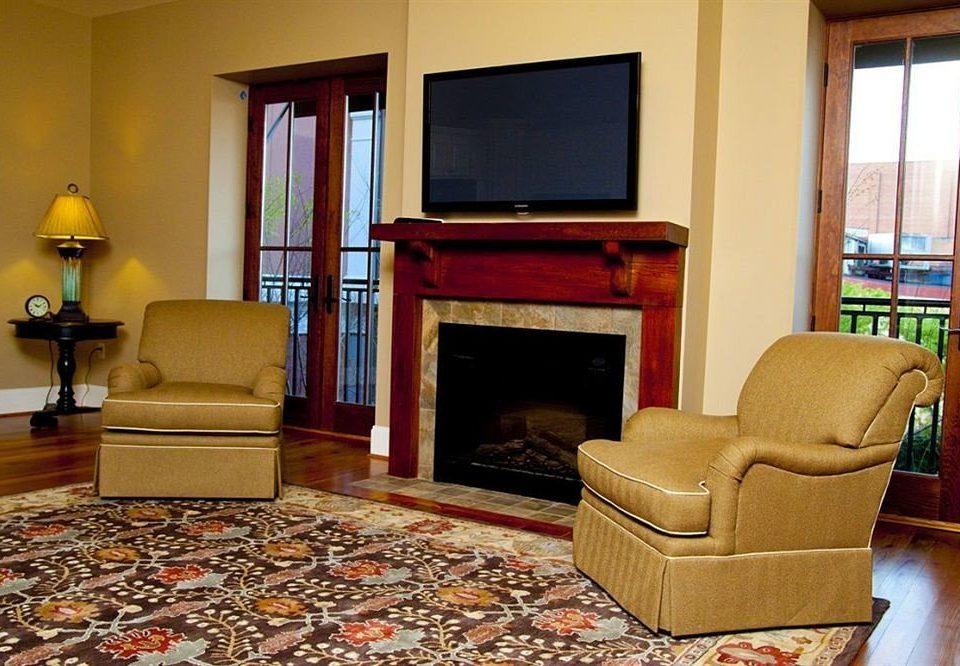 sofa living room property home Suite hardwood cottage rug flooring condominium flat containing