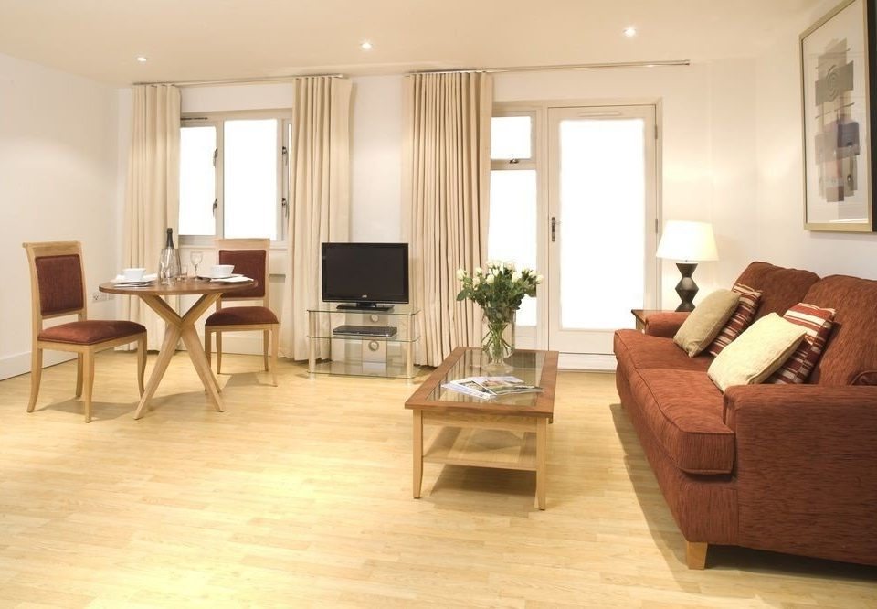 sofa property living room hardwood Suite home flooring wood flooring condominium cottage laminate flooring leather