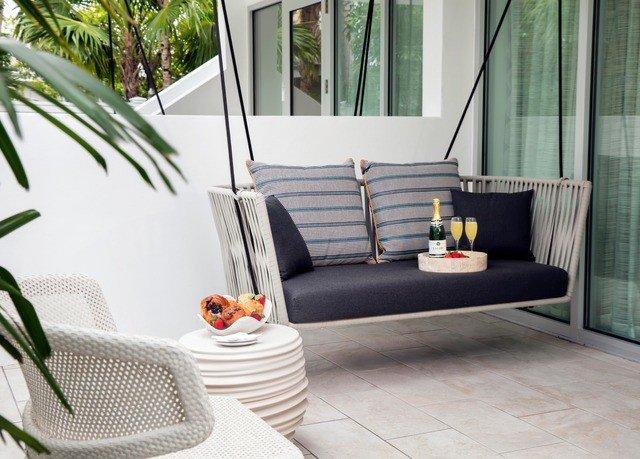 property living room home porch condominium flooring outdoor structure studio couch cottage Suite sofa