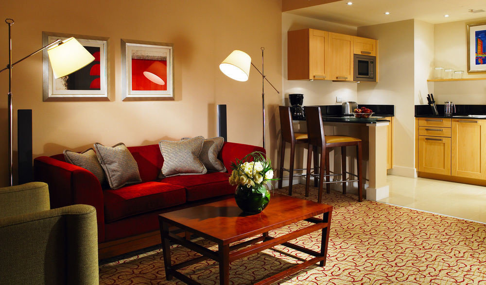 property living room home red cottage Suite hardwood condominium leather