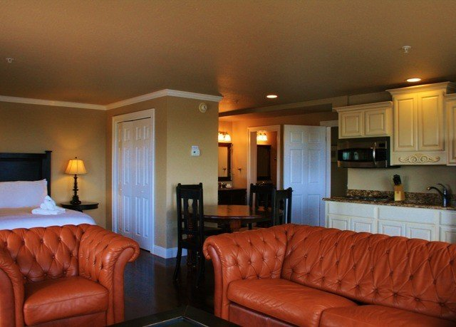 sofa property Suite living room leather home condominium cottage orange