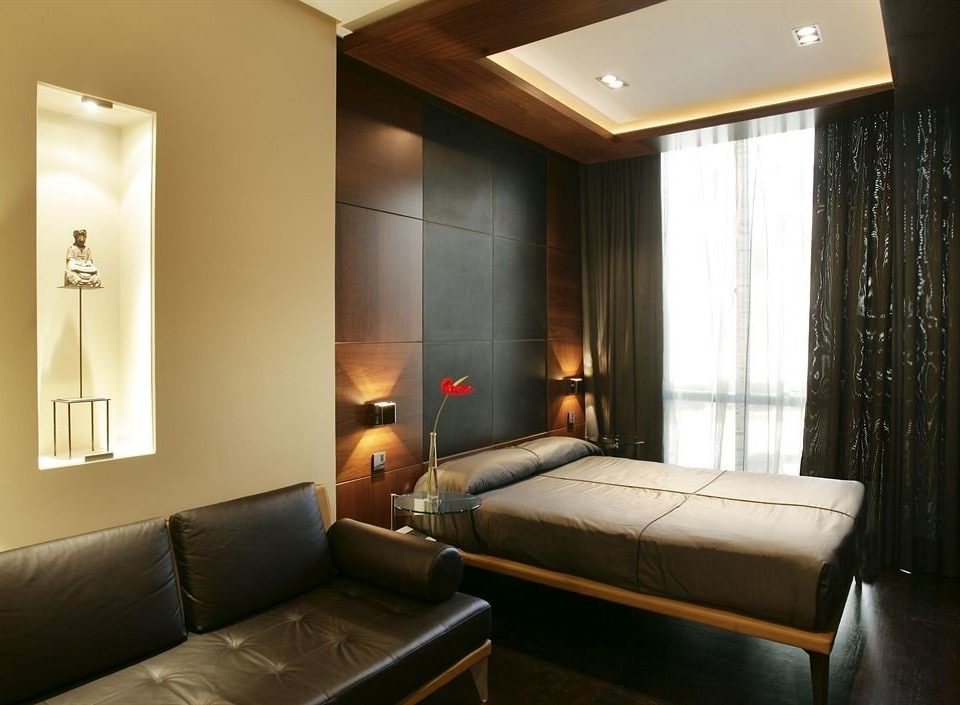 sofa property Suite condominium living room cottage tan