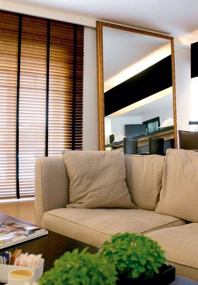 sofa living room property condominium home Suite curtain window treatment window blind flat leather