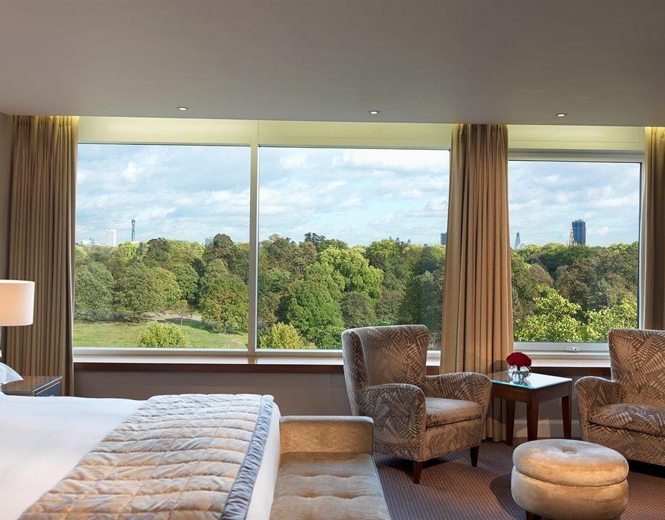 property living room home hardwood condominium nice window treatment curtain Suite overlooking flat