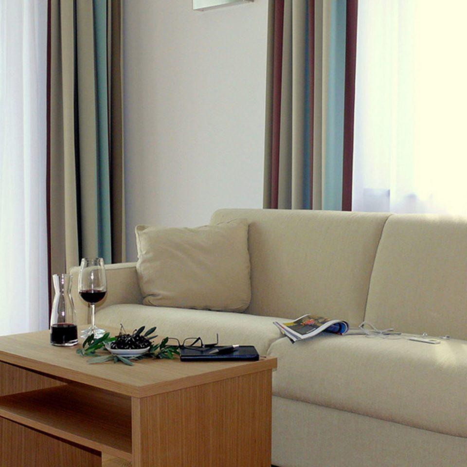 sofa property living room home condominium white Suite curtain window treatment