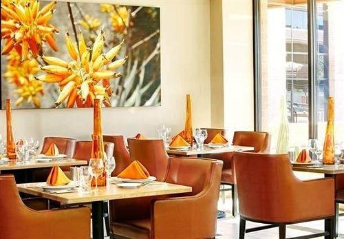 orange property restaurant living room home condominium Suite dining table