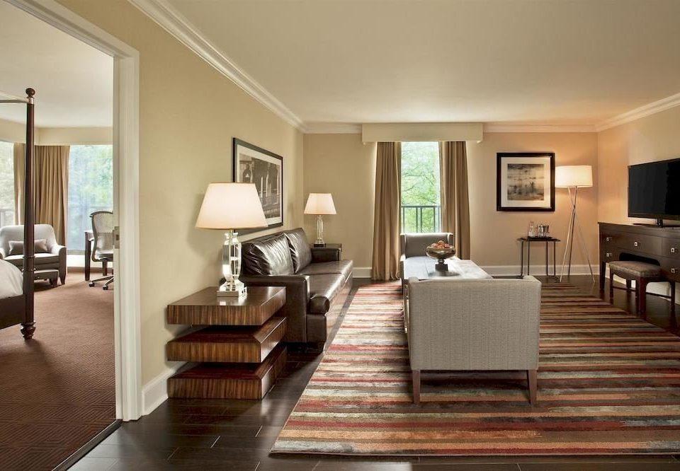 sofa living room property condominium Suite home hardwood wooden wood flooring flat