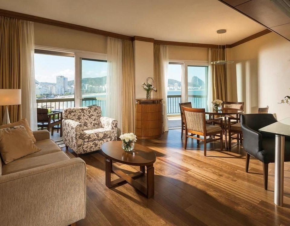 sofa property living room condominium Suite home hardwood wood flooring