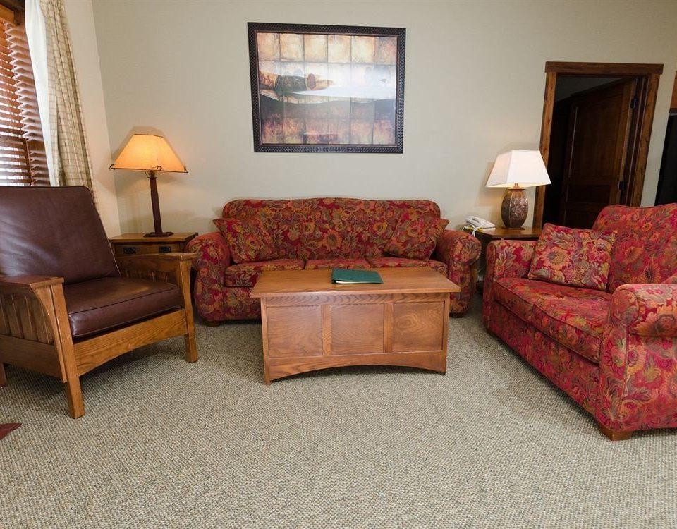 sofa living room property Suite home hardwood cottage flooring rug