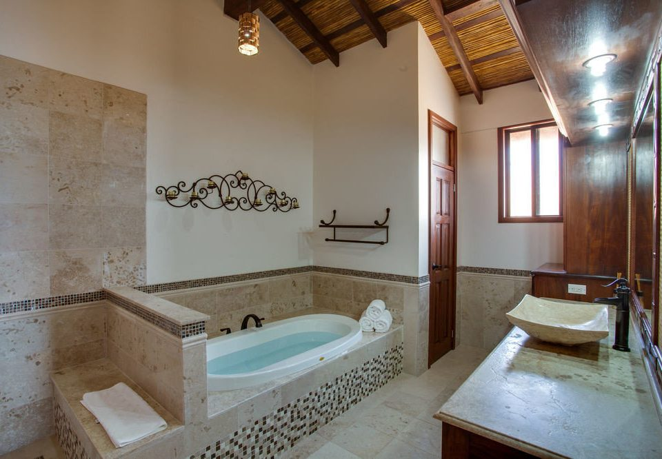 bathroom property sink house home swimming pool cottage Suite Villa tub tile bathtub