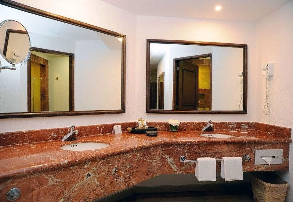 bathroom mirror sink property vanity countertop home hardwood cabinetry Suite Villa cottage mansion double stone