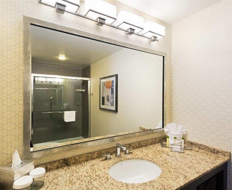bathroom mirror sink property vanity counter Suite home condominium toilet cottage Villa plumbing fixture double flooring clean tan