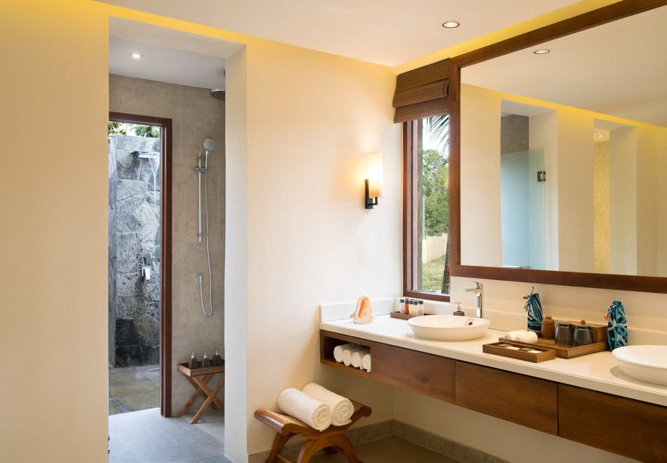 bathroom mirror property sink yellow house home Suite cottage Villa condominium