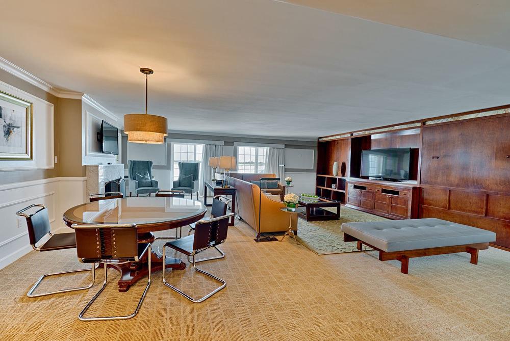 chair property home living room condominium recreation room Suite Villa