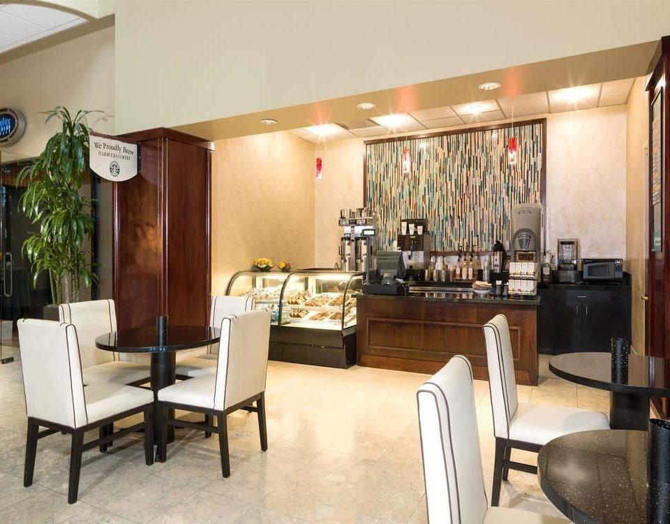 chair property condominium Suite restaurant Villa living room dining table