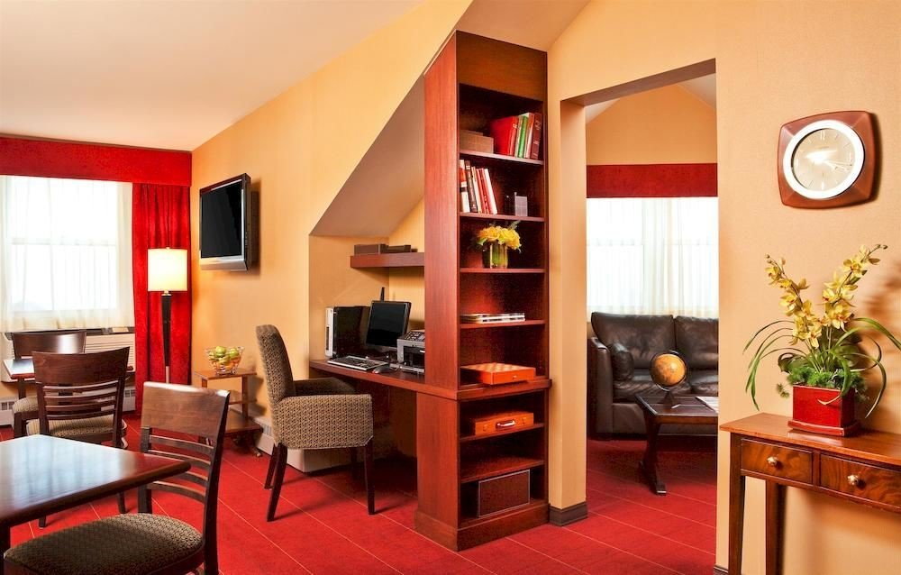 chair property Suite shelf living room condominium home cottage Villa leather