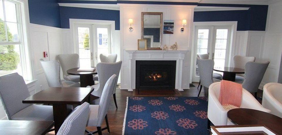 living room chair property home condominium cottage Suite Villa leather