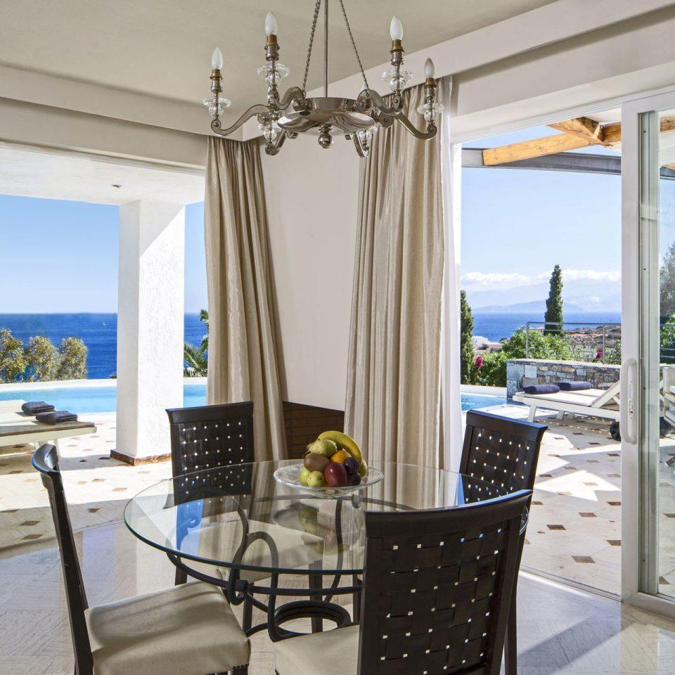property chair home living room cottage Suite condominium Villa overlooking porch
