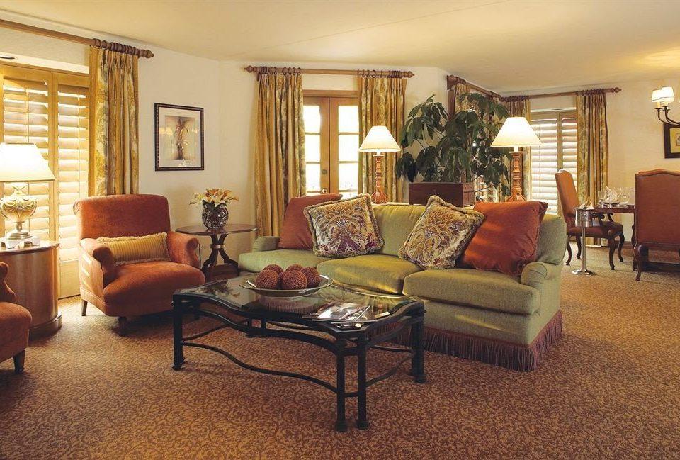 living room chair property home hardwood Suite condominium cottage Villa