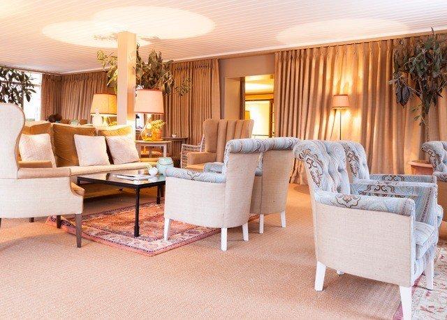 chair property living room Suite condominium home Villa cottage