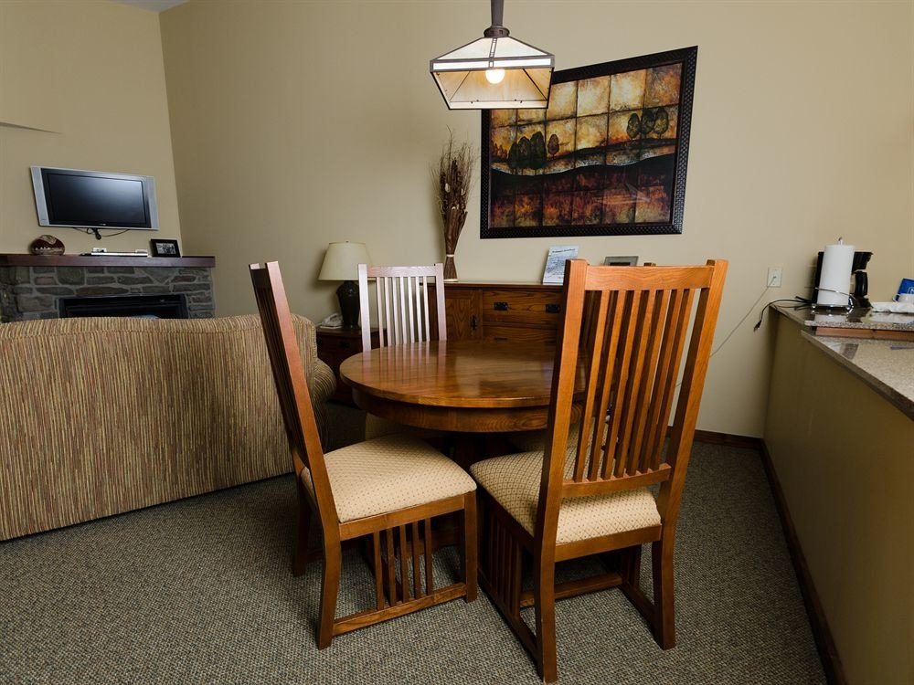chair property home house living room Suite cottage hardwood Villa dining table