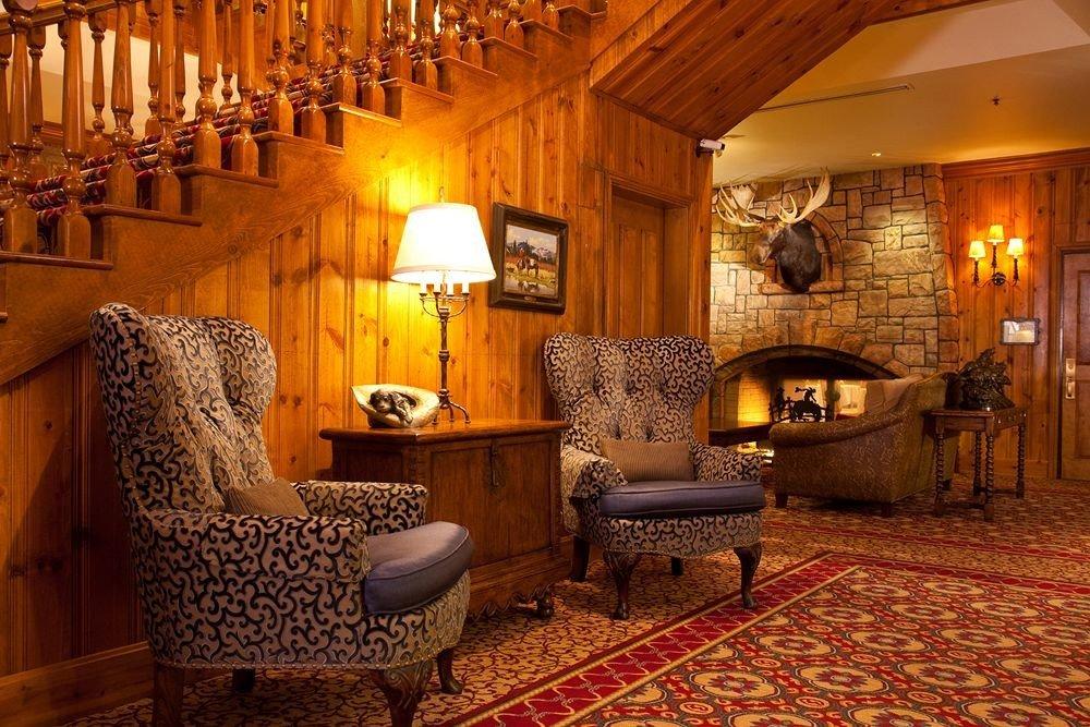 property chair living room hardwood cottage home Suite farmhouse Villa mansion wood flooring rug