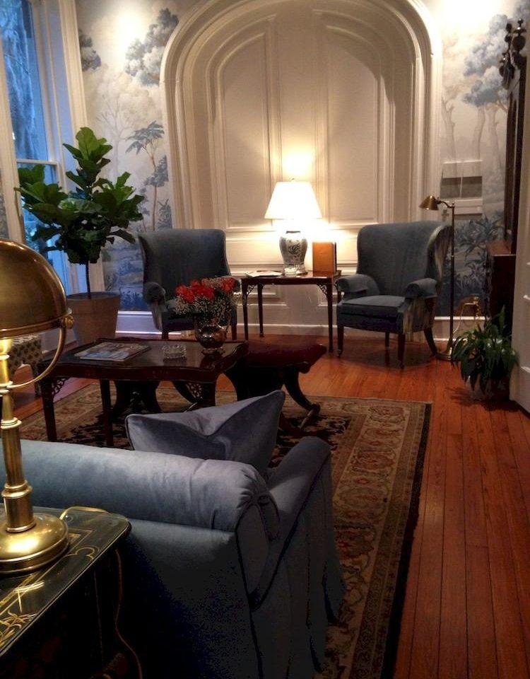 living room chair property home hardwood mansion Suite cottage Villa leather