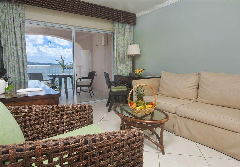 sofa property living room condominium home cottage Villa Suite containing