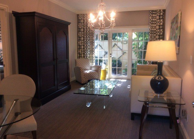 living room property home hardwood condominium Suite cottage Villa lamp dining table