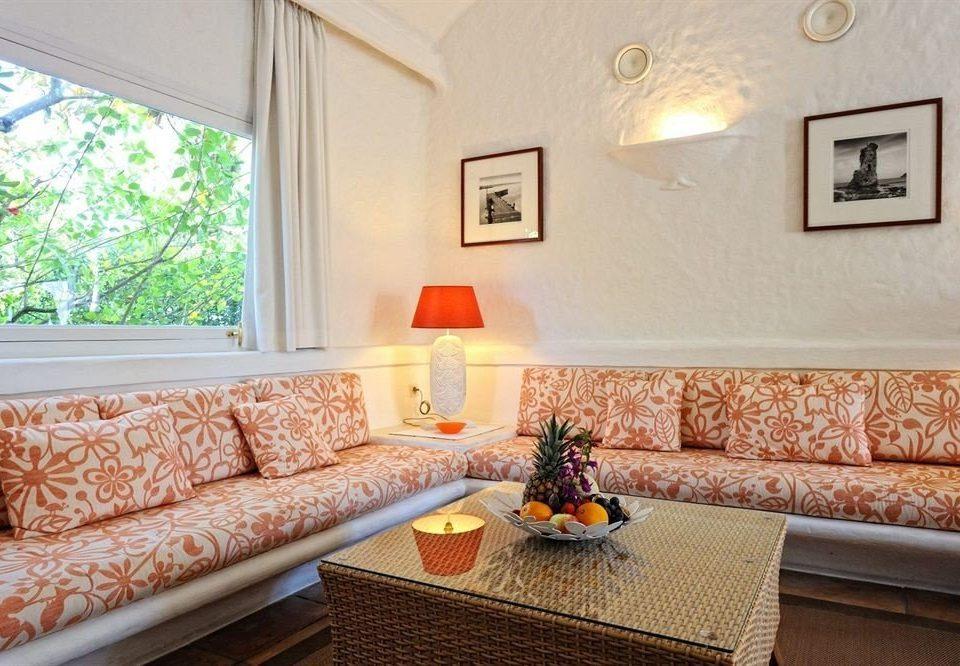 sofa property living room home cottage Suite orange Villa condominium pillow seat