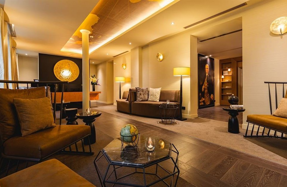 property living room yellow home Suite hardwood condominium Villa recreation room cottage