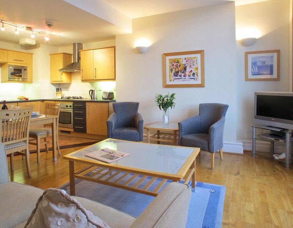 property living room condominium home cottage Villa hardwood yellow Suite