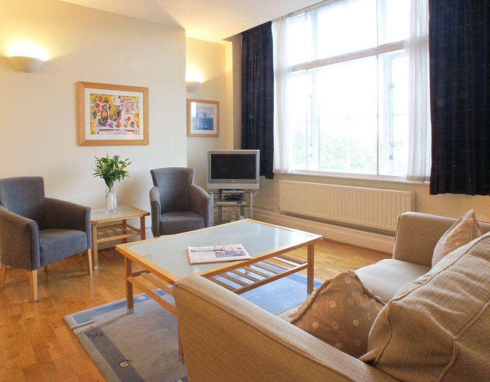 sofa property living room home condominium cottage Suite Villa
