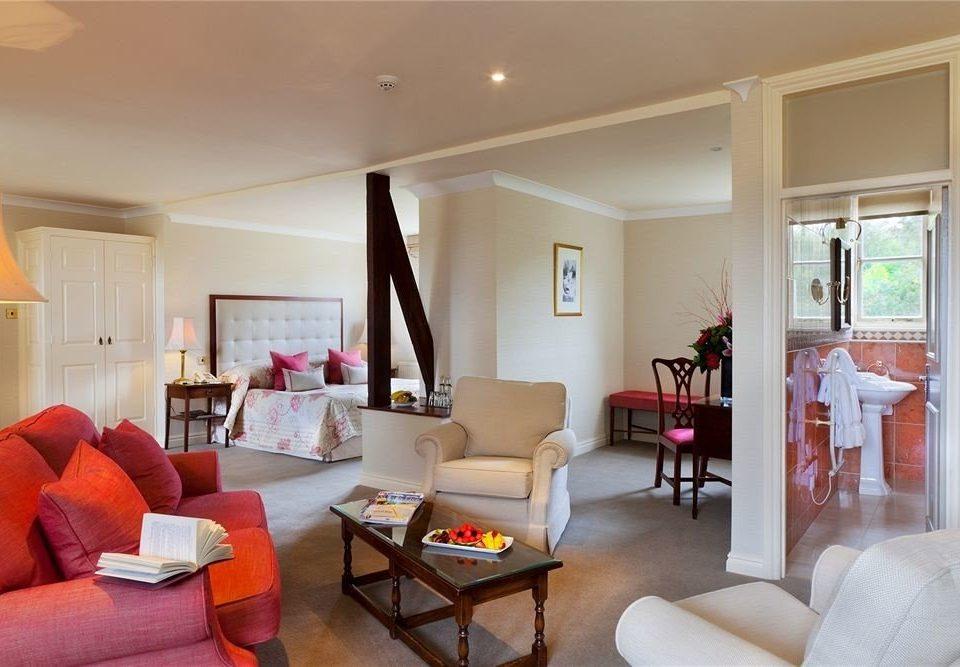 sofa property living room home condominium cottage Suite Villa orange flat