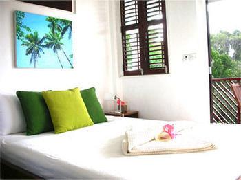 property green cottage home condominium Villa Suite living room pillow