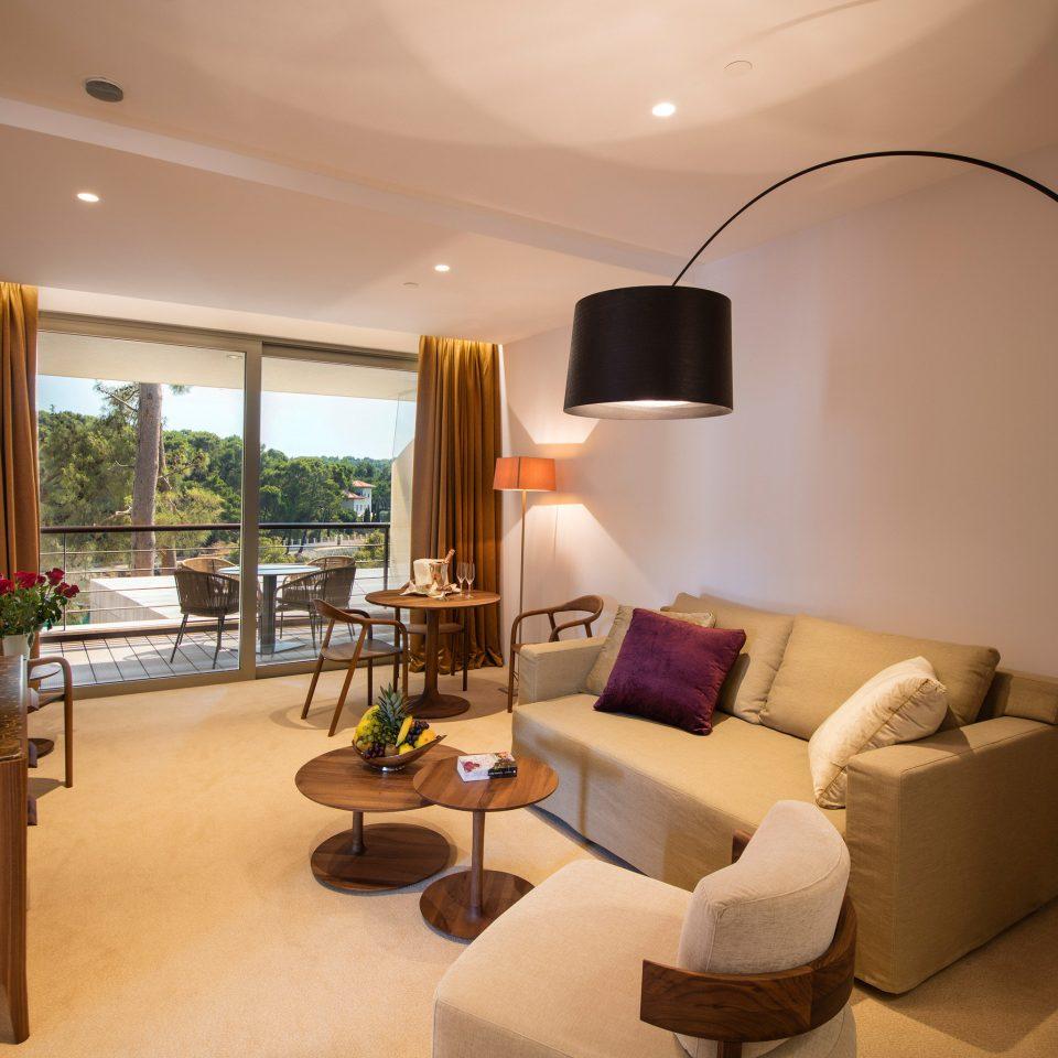 sofa property living room condominium home Suite Villa cottage flat