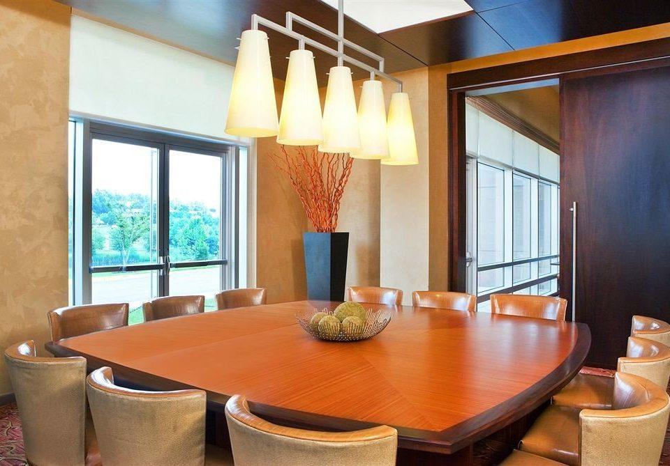 property Suite condominium home living room Villa cottage orange dining table