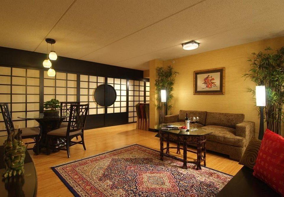 property living room home hardwood condominium cottage Villa recreation room Suite farmhouse rug