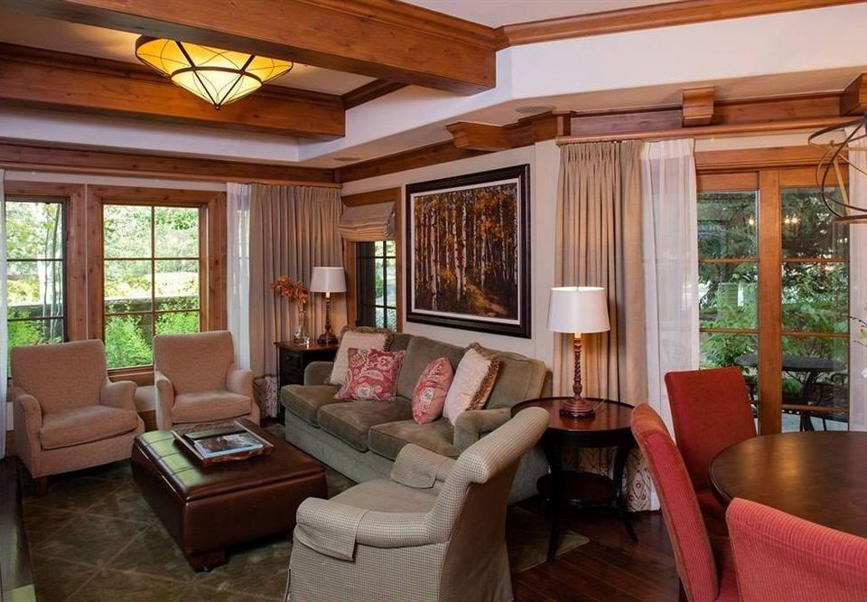 sofa property living room home cottage hardwood Villa condominium porch farmhouse Suite mansion