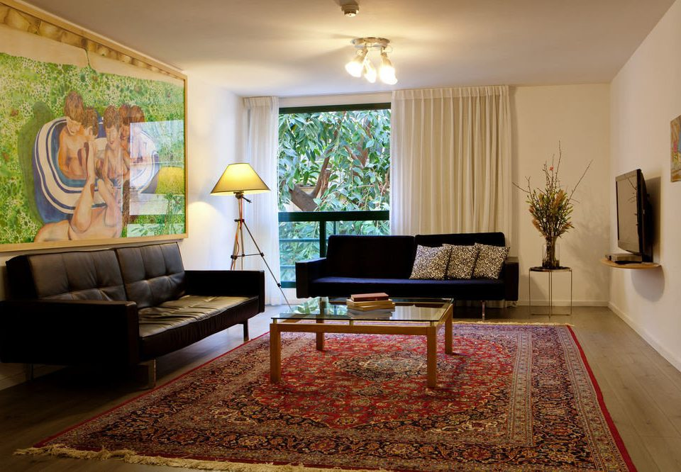 sofa living room property home rug hardwood mansion flooring wood flooring Suite Villa flat