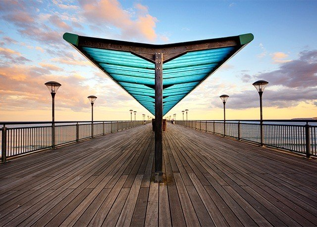 sky ground walkway pier boardwalk bridge horizon evening sunlight line symmetry nonbuilding structure dusk Sunset