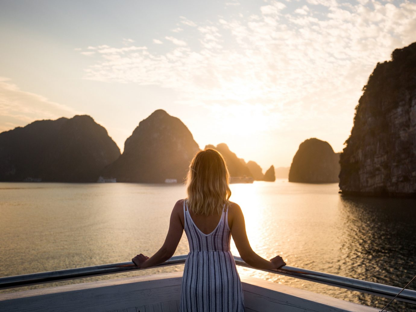Travel Tips water outdoor sky mountain Nature Sea Ocean morning Sunset vacation rock sunlight reflection Coast evening bay dusk sunrise Lake distance