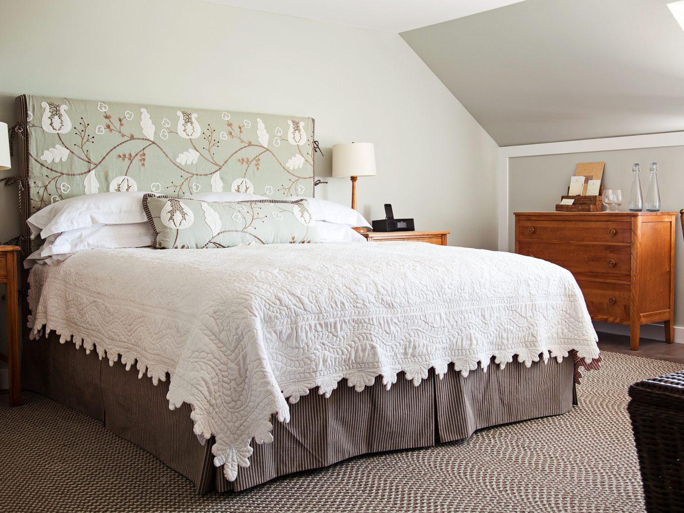 Classic Inn Waterfront bed indoor wall Bedroom room hotel ceiling bed sheet interior design Suite cottage bed frame textile furniture floor duvet cover