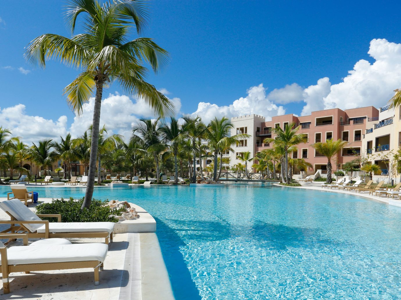 All-inclusive Hotels Kids Club Luxury Pool Resort sky tree outdoor water palm swimming pool property leisure caribbean condominium vacation estate real estate marina resort town Villa swimming lawn bay lined sunny shade shore day