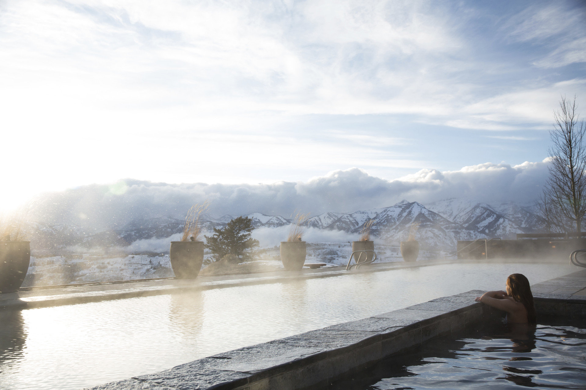 Hotels Luxury Travel Mountains + Skiing Offbeat outdoor water sky Winter atmospheric phenomenon snow weather reflection freezing Nature morning season ice River wave sunlight Lake Sea mist water feature spring shore