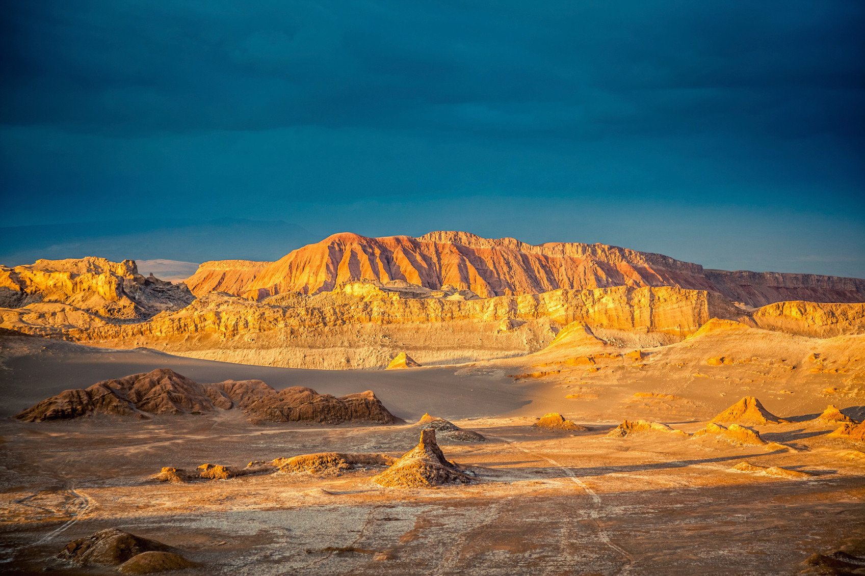 Influencers + Tastemakers Travel Shop Trip Ideas Nature sky outdoor mountainous landforms geographical feature landform wilderness natural environment canyon rock valley mountain landscape sunrise badlands Sunset plateau wadi Desert dawn orange Coast butte terrain dusk Sea formation geology cliff