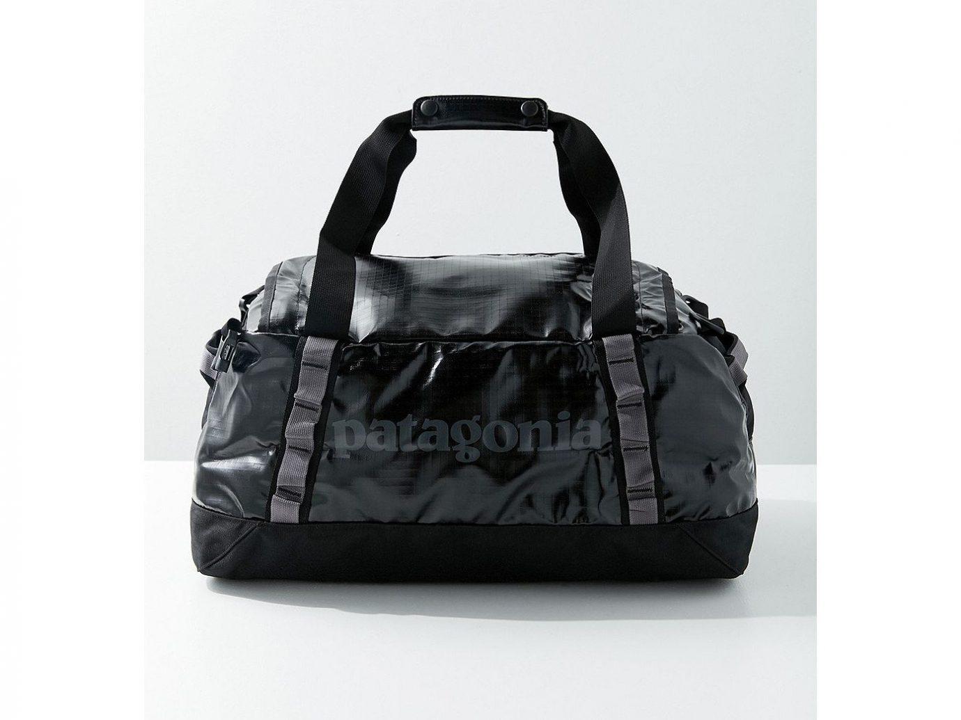 Packing Tips Style + Design Travel Shop bag black handbag shoulder bag product fashion accessory leather hand luggage product design luggage & bags brand strap baggage pattern
