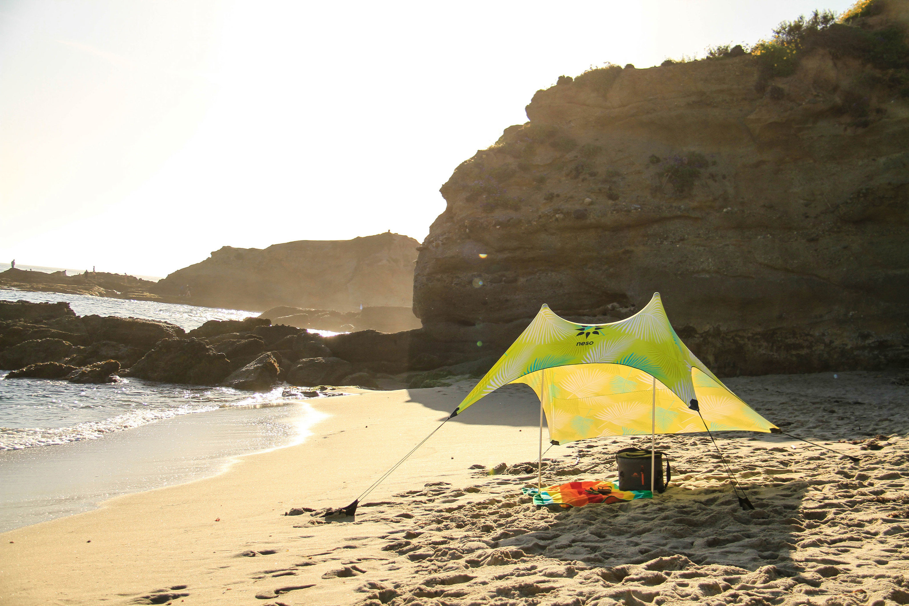 Travel Tips outdoor sky Beach Sea body of water mountain Coast shore Ocean wave sand bay Nature boating vehicle cape sport kite